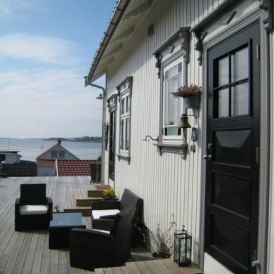 Sørlandssol og Solfjedvinduer i sveitserstil..